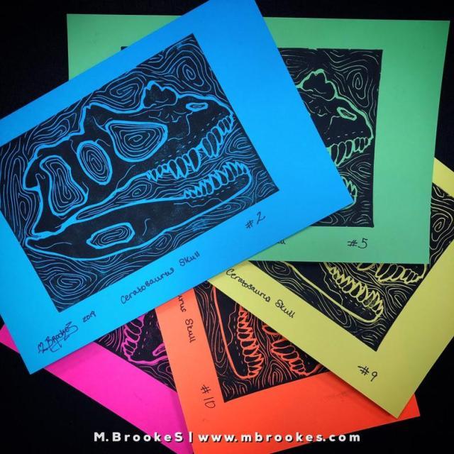 Ceratosaurus skull linocut prints on bright paper