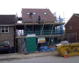 Our more modest scaffolding and house!