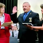 N.C. Secretary of State Elaine Marshall administers the Oath of Office to newly appointed Sheriff Mike Roberson during a May 25 ceremony in Chatham County. Roberson's wife Annette Roberson held the Bible during her husband's oath.