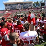 NC State football coach Dave Doeren speaks to his players after the spring football game.