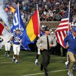 Duke football team runs into Wallace Wade stadium.