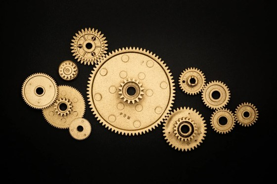 photo of golden cogwheel on black background
