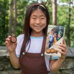 Girl Scout with new cookie