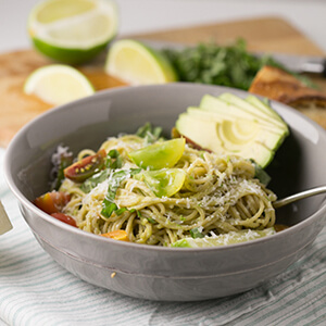 This creamy avocado-lime pasta, topped with shredded basil, is a simple, quick, and delicious vegetarian lunch or dinner! | Recipe from Chattavore.com