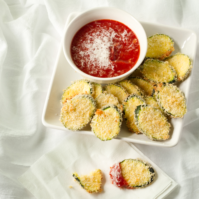Crispy oven fried zucchini is so easy and it's a great snack or side dish to use up all your summer zucchini without the mess of frying! | recipe from Chattavore.com
