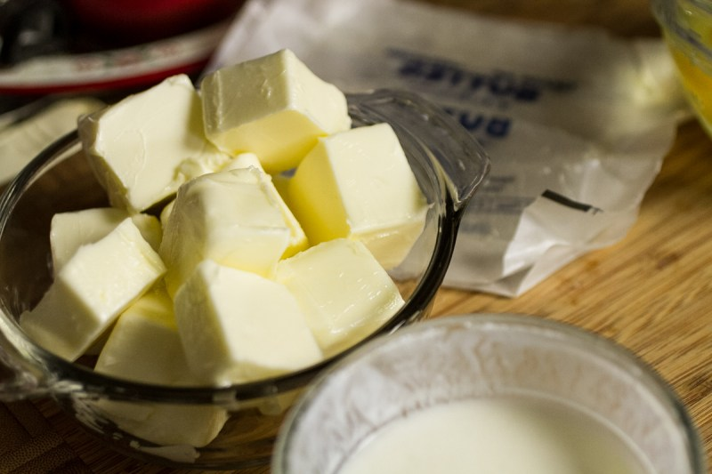 a close-up photograph of a bowl of cubed butter