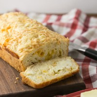 This quick beer cheese bread is easy and so tasty that you'll want to make it every week! It's great with soup or just as a snack! | Recipe from Chattavore.com