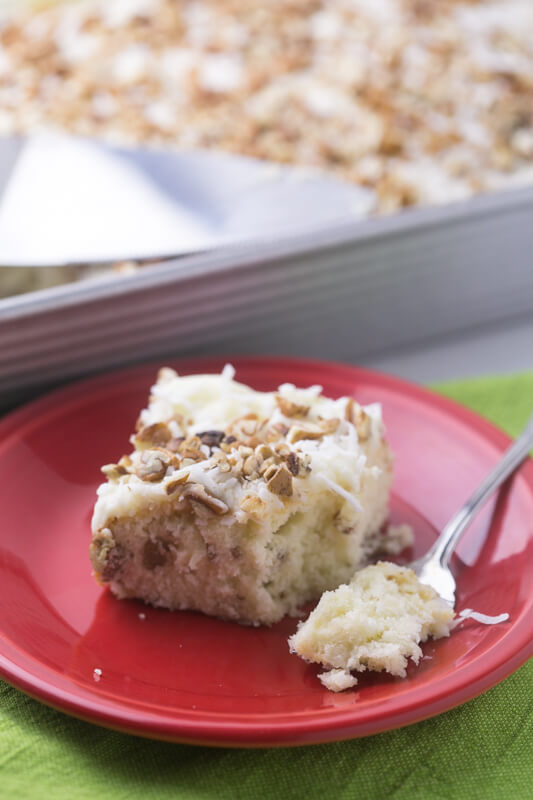 Italian cream sheet cake is a classic Southern cake made simple in a sheet pan. With cream cheese icing, pecans, and coconut, it's perfect! #cakes #baking #sheetcake #italiancreamcake #southernfood | Recipe from Chattavore.com