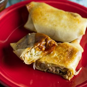 What could be better than pulled pork, barbecue sauce, and coleslaw in a baked egg roll? That's right, NOTHING! // chattavore.com