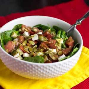 Spinach caprese salad showcases all the flavor of perfect summer tomatoes with a delicious pesto vinaigrette!   chattavore.com