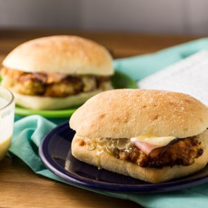 This chicken cordon bleu sandwich is easy and delicious, with crispy chicken topped with ham, Swiss cheese, and honey mustard sauce on a bakery bun!   recipe from Chattavore.com