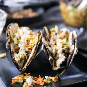 These Asian pork tacos are made with tender pork shoulder & light, delicious slaw & come together so quickly in the pressure cooker or Instant Pot!   recipe from Chattavore.com