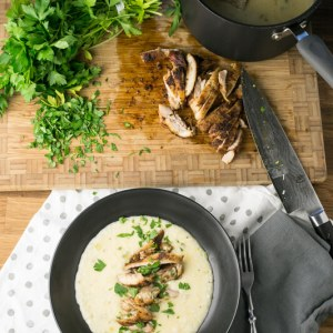 Fall is coming up, and that means it's time for warm comforting meals. These cheesy, creamy grits topped with Cajun chicken thighs fit the bill!   recipe from Chattavore.com