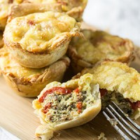 Sausage and red pepper mini quiches come together so quickly and they're so easy to make...and delicious, of course. They're great for brunch!   Recipe from Chattavore.com