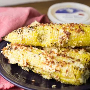 Southern street corn is loaded up with all kinds of good stuff - The Chef and His Wife pimento cheese, mayo, and bacon - for a delicious side dish! #ad #thechefandhiswife | Recipe from Chattavore.com