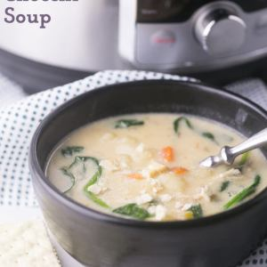 A bowl of chicken and gnocchi soup with crackers and an Instant Pot in the background