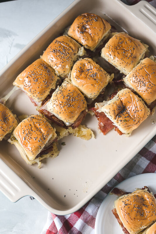 an overhead photograph of a pan of bacon sliders with pineapple-jalapeño jelly