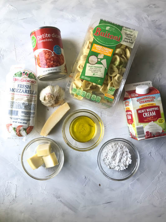 a photograph showing the ingredients of baked creamy tortellini