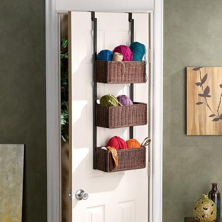 Hey knitters and crafters! Look what I found! Is this idea gorgous or what? I REALLY like that it hangs beautifully on the door. Oh and you could also think of using this for your fabrics collection too.