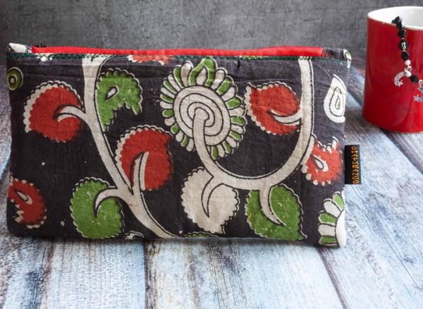 Slim Pouch Kalamkari Black Red Green 1 https://chaturango.com/kalamkari-slim-pouch-black-red-green/