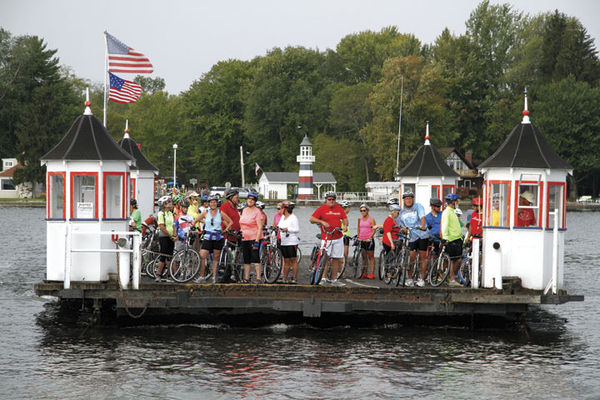 A group of cyclists enjoy a ride across the lake on the historic Bemus Point-Stow Ferry during the 2015 Chautauqua Gran Fondo.