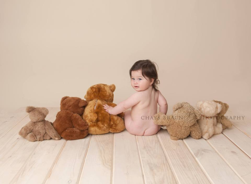 baby sitting backwards with teddy bears