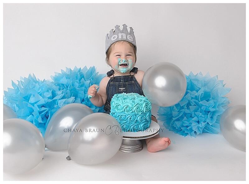 boy cake smash photos blue and silver