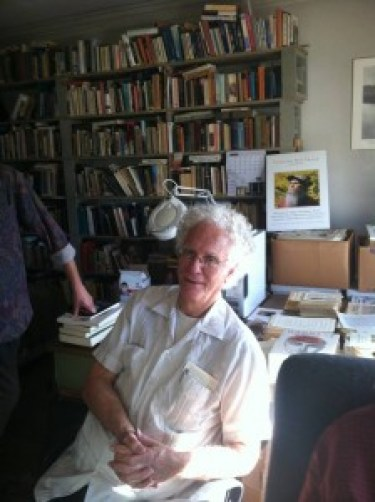 Wade Hudson sitting in Leonard Frank's library.