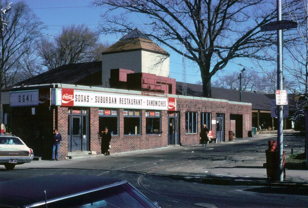 "Photograph from the John McArthur Harris photograph collection, of the Suburban Restaurant, formerly located at 8641 Germantown Avenue and next to ""Top of the Hill"" shops. The restaurant building was torn down in the early 1970's. The Susan Pizzano Memorial Fountain is there now."