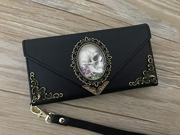 Your goth will love this cell phone case that doubles as a wallet.