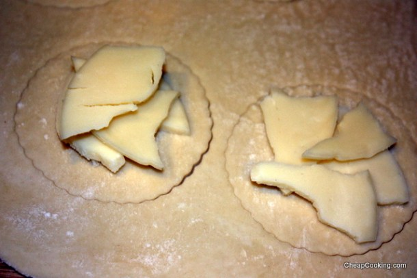 cutting out provolone turnovers
