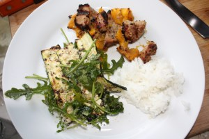 pork and mango kebabs, rice, grilled zucchini salad