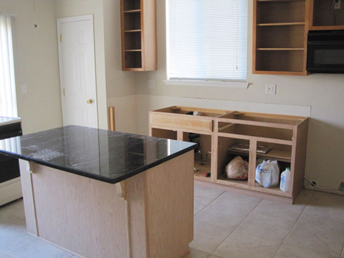 Installing new Black Pearl granite countertops as part of my DIY kitchen remodeling project