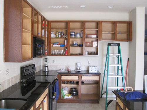 Cabinet frames stained, working on tile backsplah