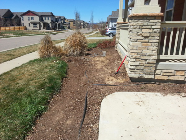Removing and cleaning up wood mulch, old landscape fabric around the house