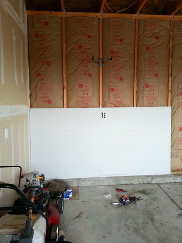 Finishing the garage walls, installing drywall panelling