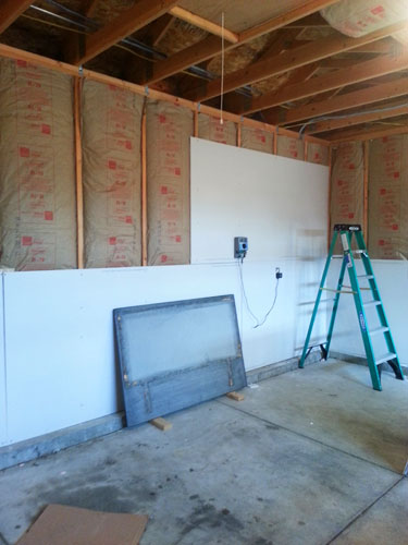 Finishing the garage part 1 insulating and drywalling walls and ceiling for Do you insulate interior walls