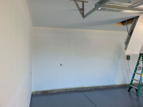 Priming, before painting garage walls