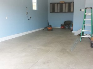 Garage floor prior to porcelain tile installation