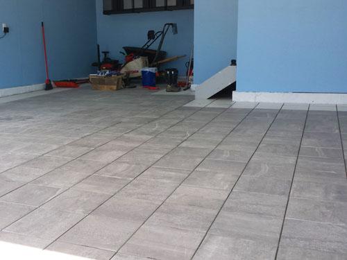 Garage porcelain tile floor almost completed