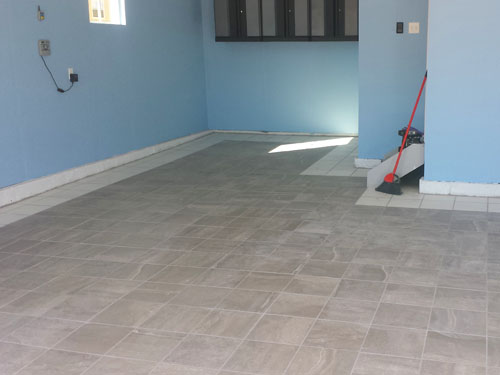Garage porcelain tile installation