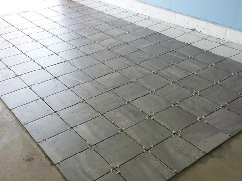 Gray porcelain tile in the garage floor