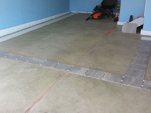 Tile positioning for porcelain garage floor