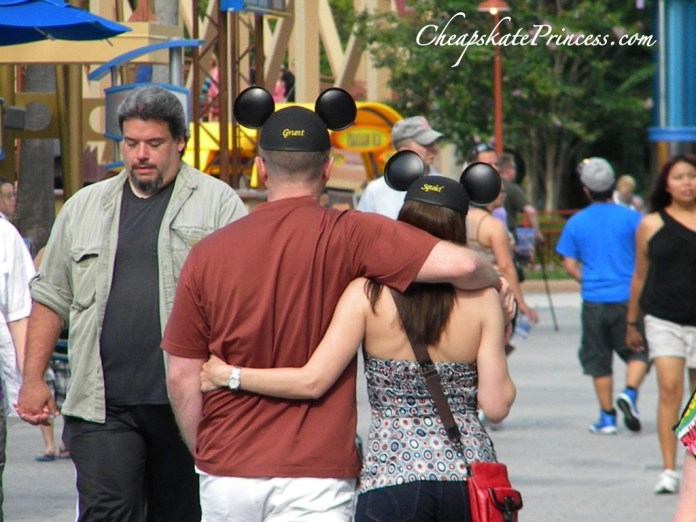 walking in Mickey Mouse hat, couple wearing Mickey Mouse hats, Mickey Mouse hat, couple in love, couple in love at Disney