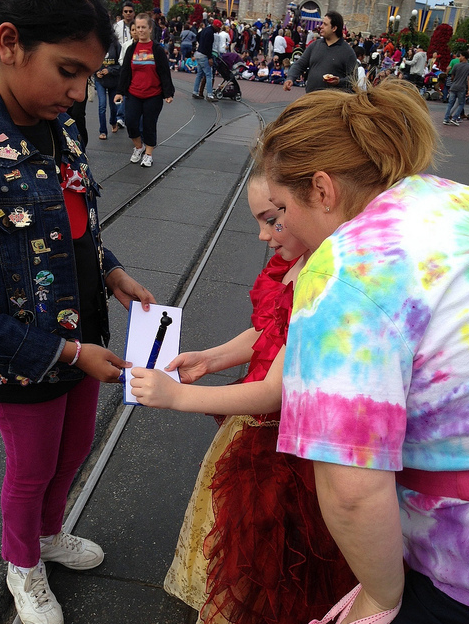 Disney princess signs autographs
