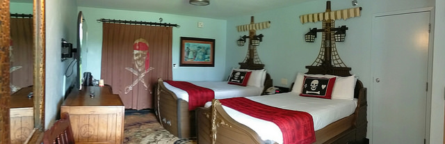 Caribbean Beach Pirate Themed Room with curtain separating the bath area.