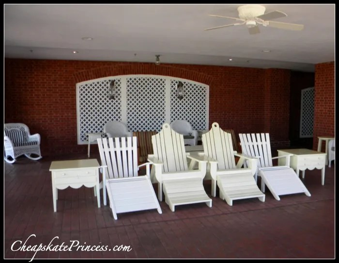 A ceiling fan and a shady chair can be found at the Boardwalk Resort
