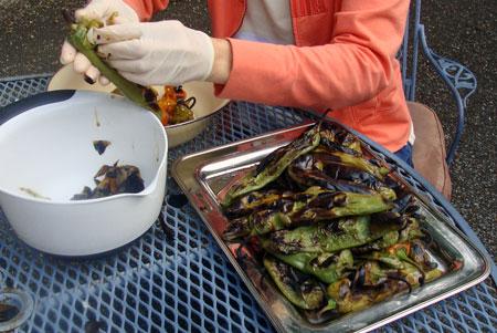 peeling green chiles