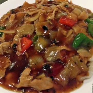 Wok fried sliced pork with flat rice noodle in black bean sauce at Harbour Kitchen - Wan Chai, Hong Kong, China