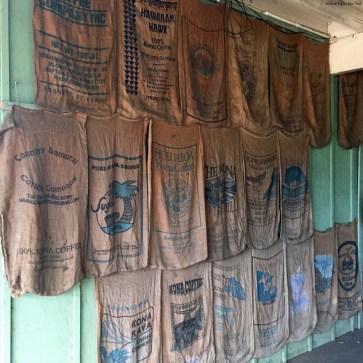 Various burlap coffee sacks once used by the Holualoa Kona Coffee Company - Holualoa, HI